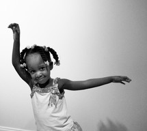Girl holding arms up