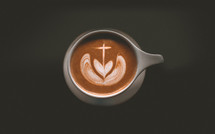 cup of coffee with cross and heart shape