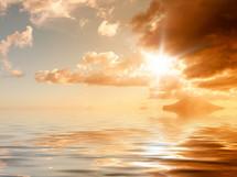 sunburst over the ocean at sunset