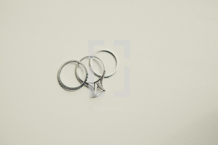 Wedding bands with diamonds from a woman's wedding ring isolated on white