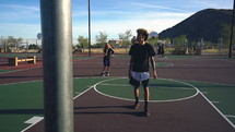 playing basketball outdoors
