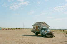 abandoned truck in a desert with Biblical references