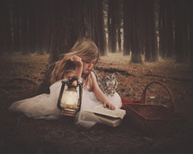 a girl reading in a forest with a lantern