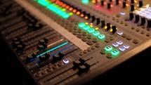 a man controlling a soundboard