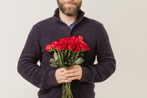 man holding red long stem roses