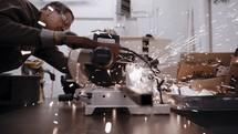 man welding in a shop