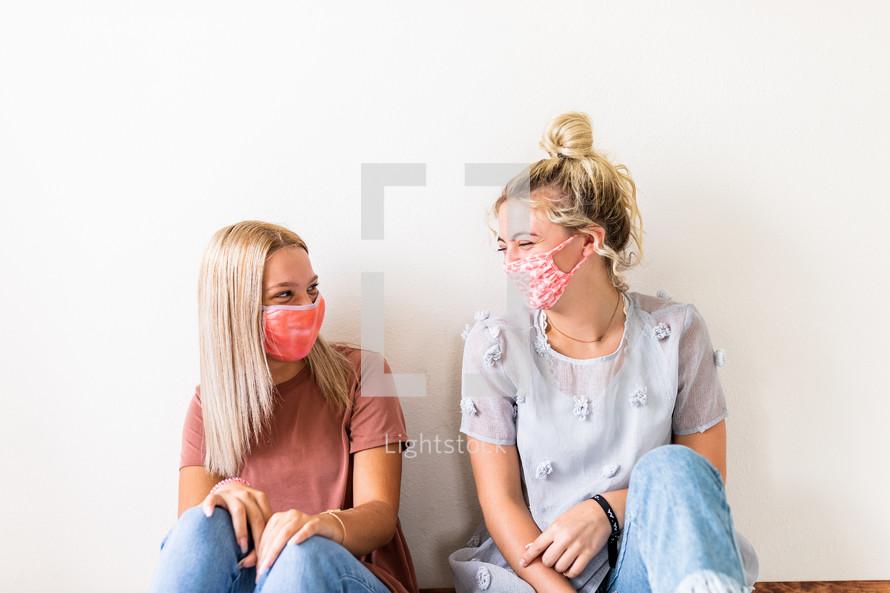 teen girls in face masks