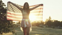 A young woman with an American flag wrapped around her
