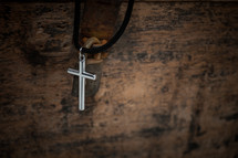 cross necklace on a wooden box