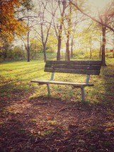 empty park bench in fall