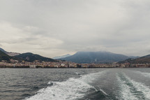 view of coastal cities in Italy and boat trail