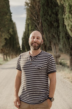 a man standing in the middle of a gravel road in Italy