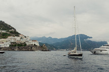 sailboat and yacht in the waters of Italy