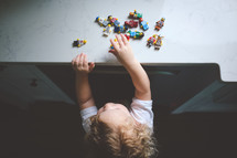 toddler playing with lego minifigures