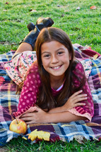 young girl on a fall blanket