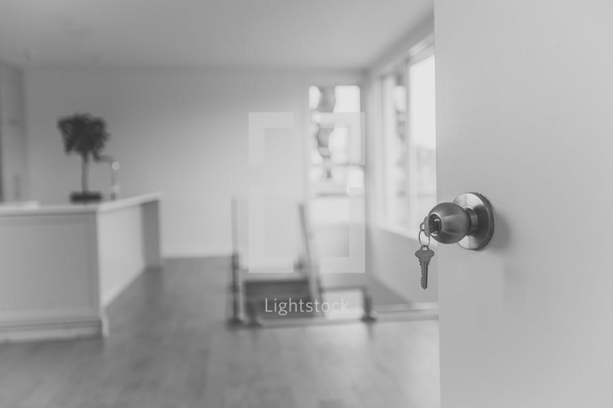keys in the door of an empty house