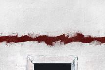 red paint above a door