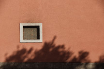 small window on the side of a house in Italy