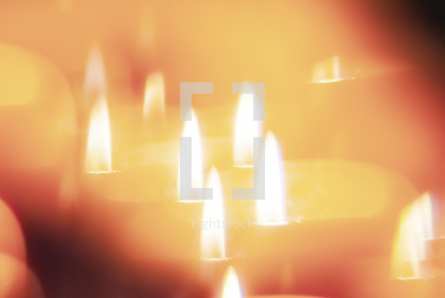 Candle flame seen through faceted crystal