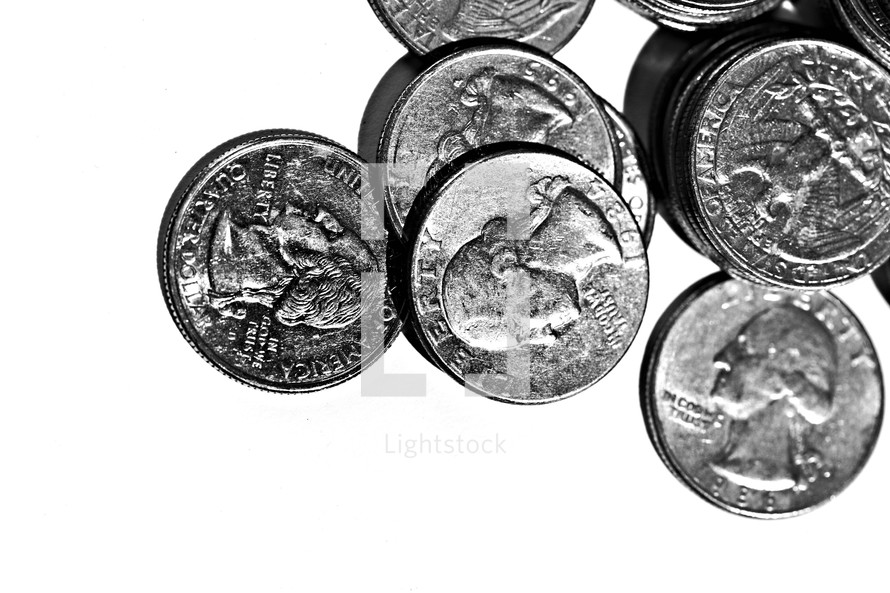 Quarters spread out on a white background