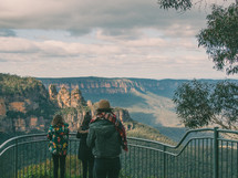 people at a viewing site overlooking the Blue Mountains