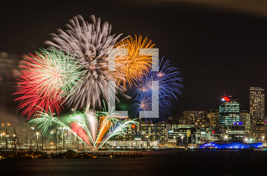 fireworks bursting over a city