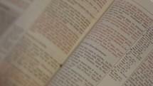 Various shots of a man reading a bible