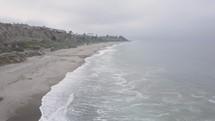 aerial view over a beach shoreline
