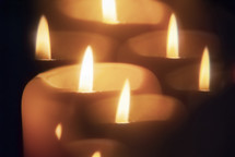 Candle seen through faceted crystal
