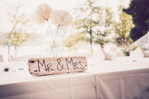 Mr and Mrs sign and white tablecloth on a table