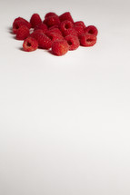 A bunch of raspberries isolated on white