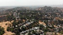 Aerial Shot Ascending Over East Los Angeles Neighborhood on a Smoggy Day