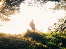 man standing under intense sunlight
