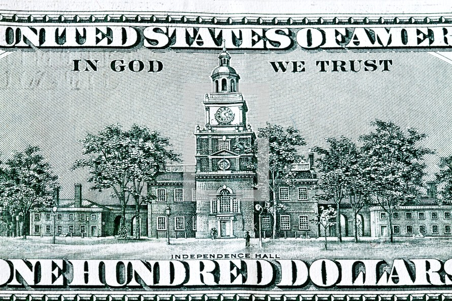 The backside of a one hundred dollar bill - Independence Hall - In God We Trust