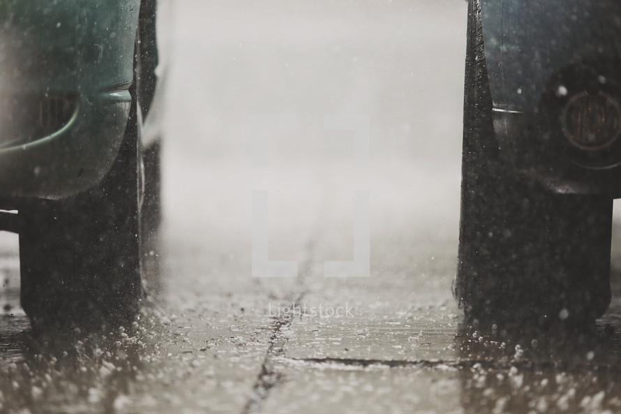 downpour of rain and vehicles