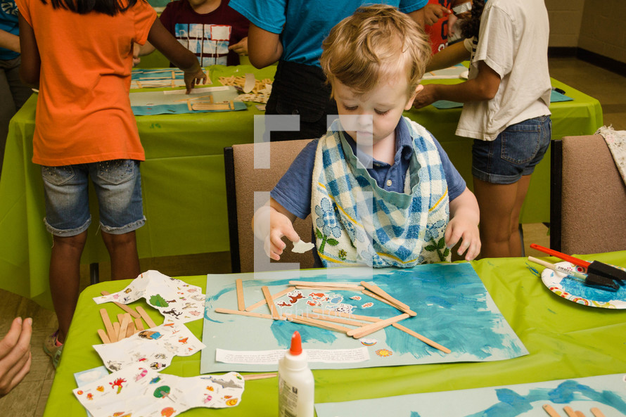 toddler making a picture