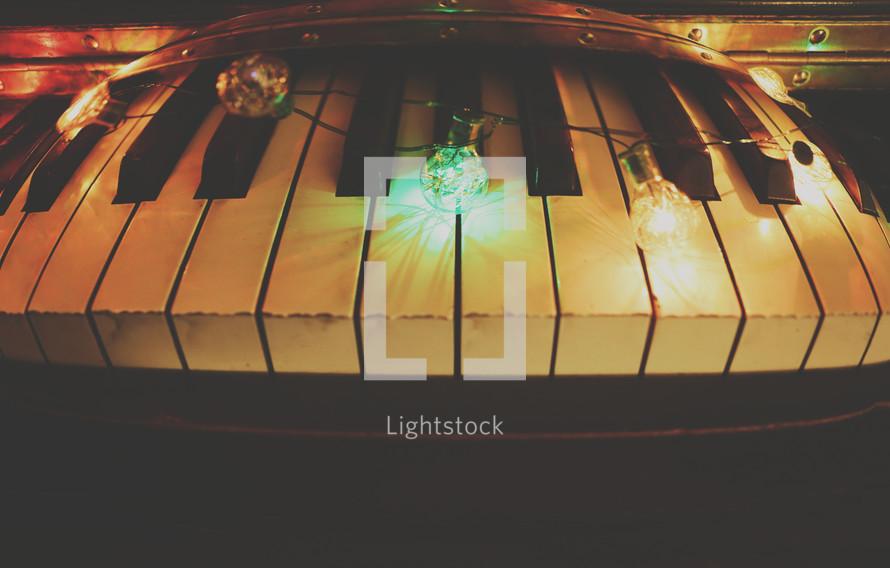 Christmas lights on a piano