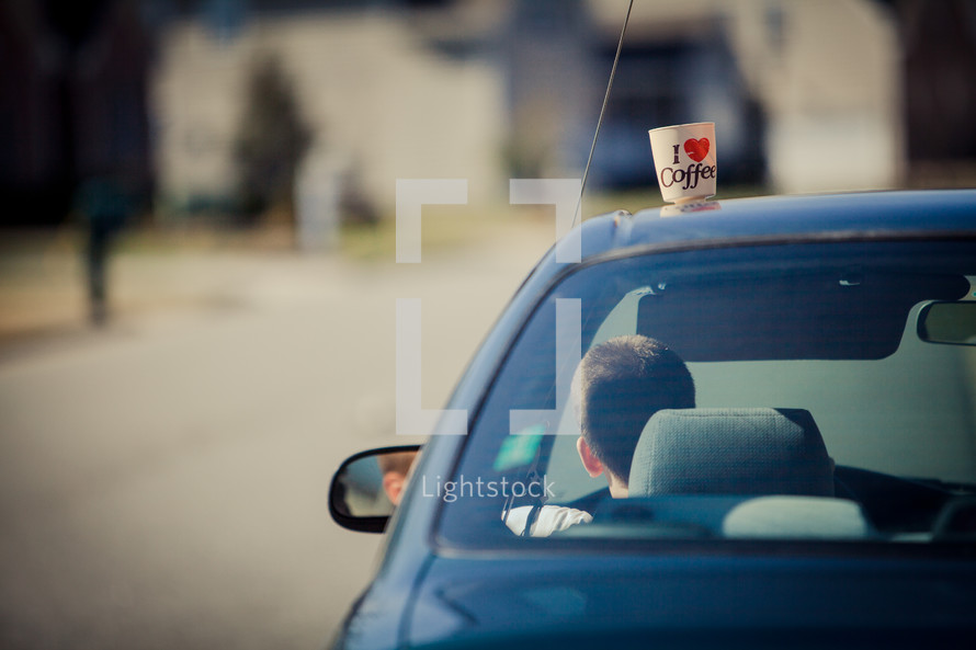 I heart coffee on top of a moving car roof