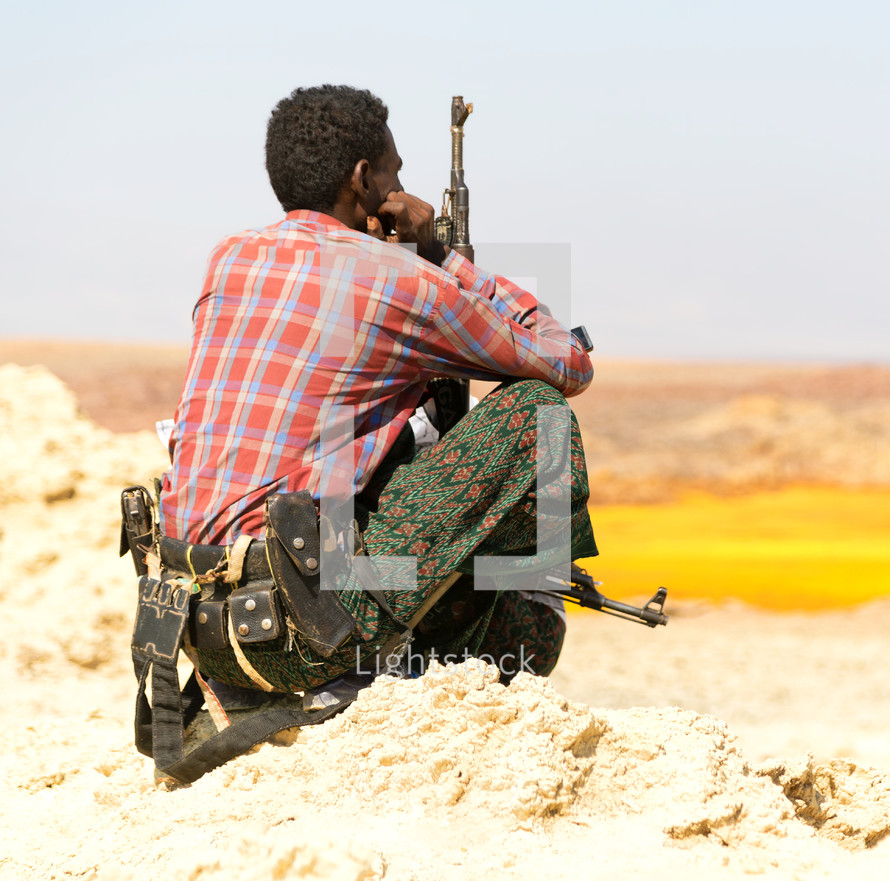 soldiers with guns patrolling the border in Africa