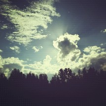 sunlight behind the clouds