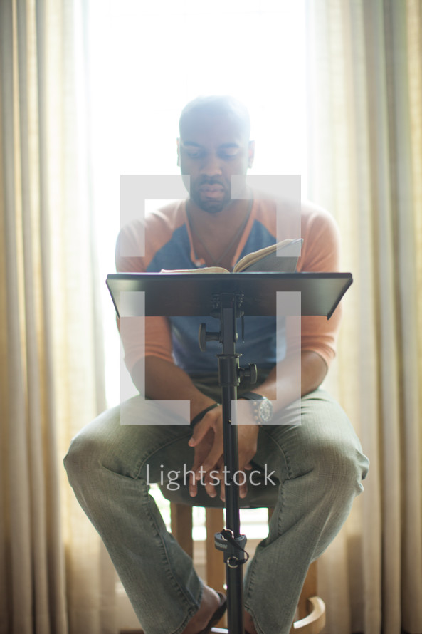 An African American man leading a fall Bible study