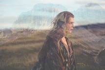 double exposure of rugged mountains and young woman