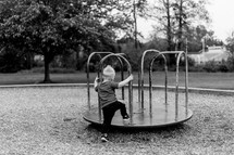 toddler boy on a playground