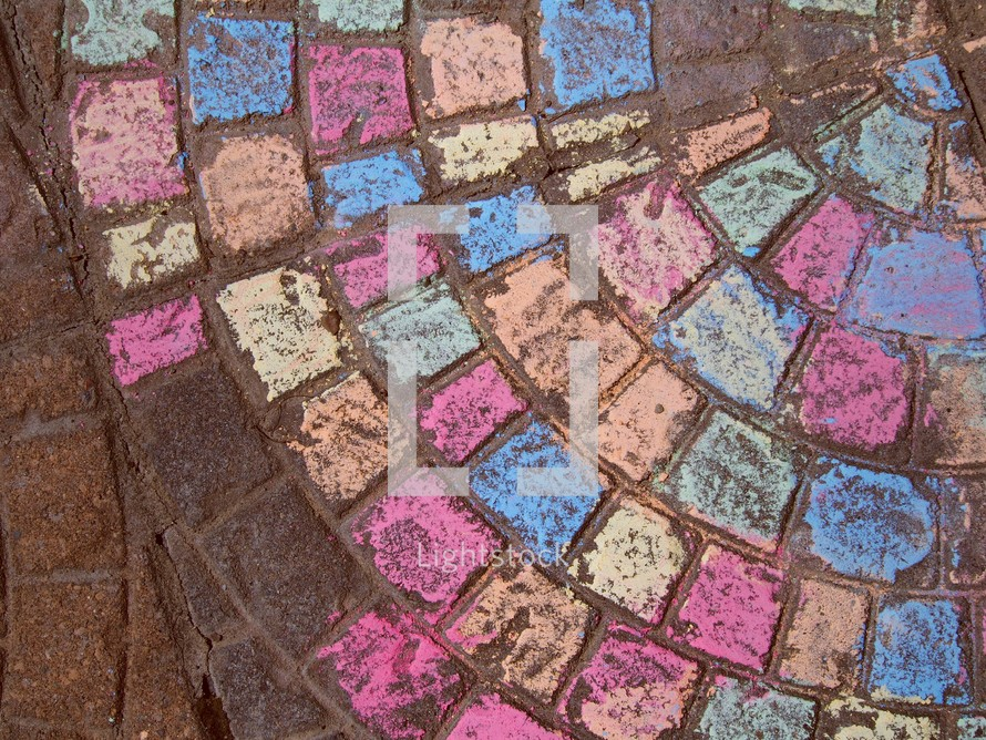sidewalk chalk coloring on patio bricks