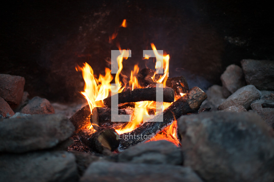 flames from a fire in a fire pit