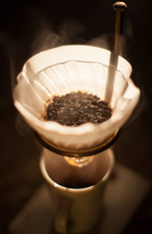 steam rising from a coffee filter