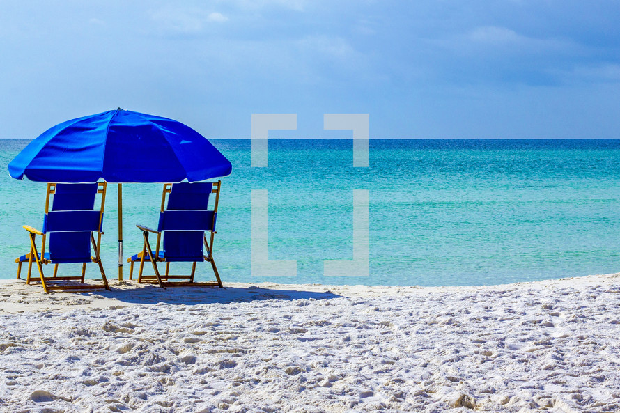 Two blue chairs overlooking Gulf of Mexico