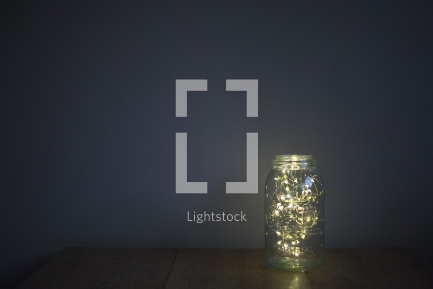 string of lights in a mason jar