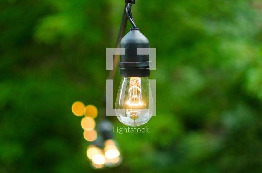 hanging lightbulbs outdoors
