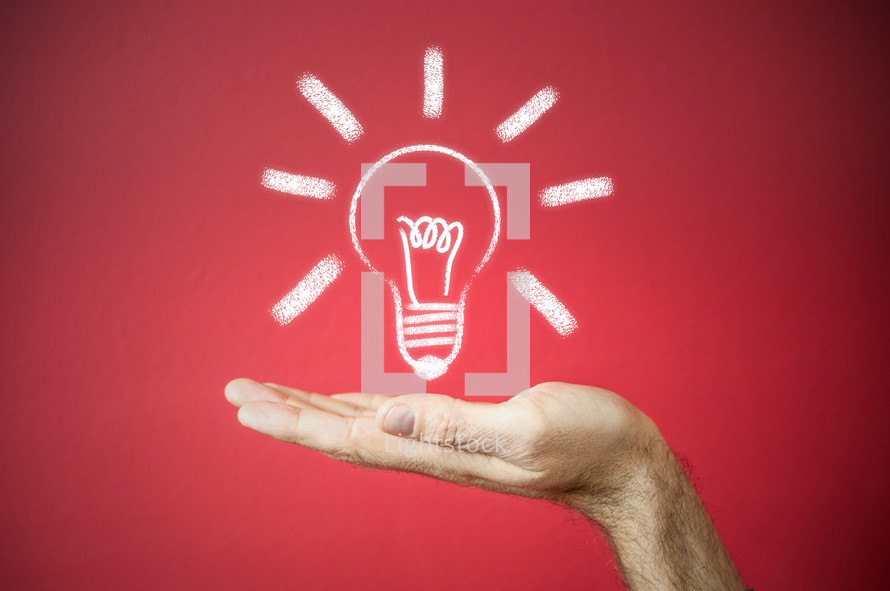 """a chalk outline of a bulb """"idea"""" supported by an outstretched hand on a red background"""